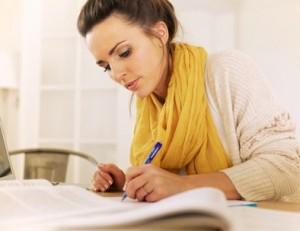 Studious Woman Writing Something