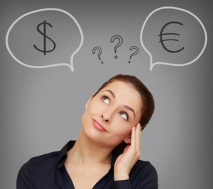 Business woman thinking about euro or dollar currency on grey ba